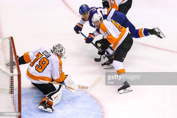Anders Lee of the New York Islanders scores a goal past Carter Hart of the Philadelphia Flyers during the third period in Game Three of the Eastern...