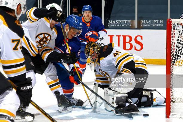 Anders Lee of the New York Islanders scores a goal past Jaroslav Halak of the Boston Bruins during the third period at Nassau Coliseum on February...