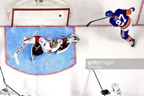 Anders Lee of the New York Islanders scores a goal past Mike Condon of the Ottawa Senators during an NHL game at Barclays Center on April 9 2017 in...
