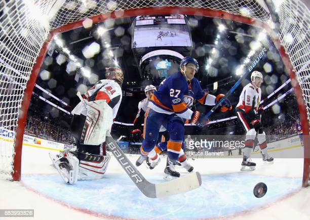 Anders Lee of the New York Islanders scores a powerplay goal at 1427 of the first period against Craig Anderson of the Ottawa Senators at the...