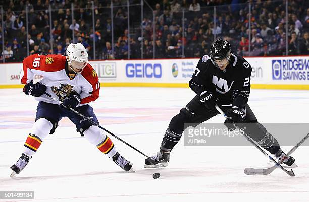 Anders Lee of the New York Islanders skates against Aleksander Barkov of the Florida Panthers during their game at the Barclays Center on December 15...