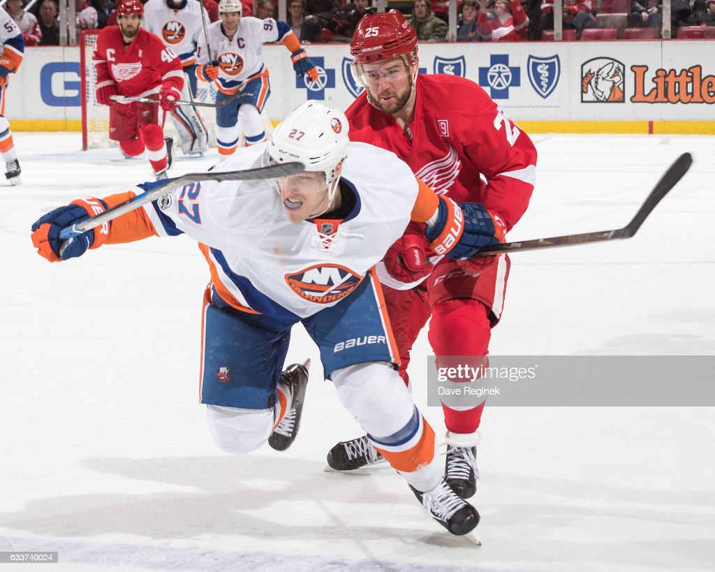 Anders Lee #27 of the New York Islanders skates in front of Mike Green #25 of the Detroit Red Wings during an NHL game at Joe Louis Arena on February 3, 2017 in Detroit, Michigan. The Wings defeated the Islanders 5-4.