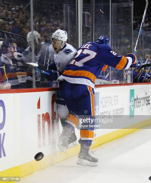 Anders Lee of the New York Islanders steps into Troy Stecher of the Vancouver Canucks at the Barclays Center on November 28 2017 in the Brooklyn...