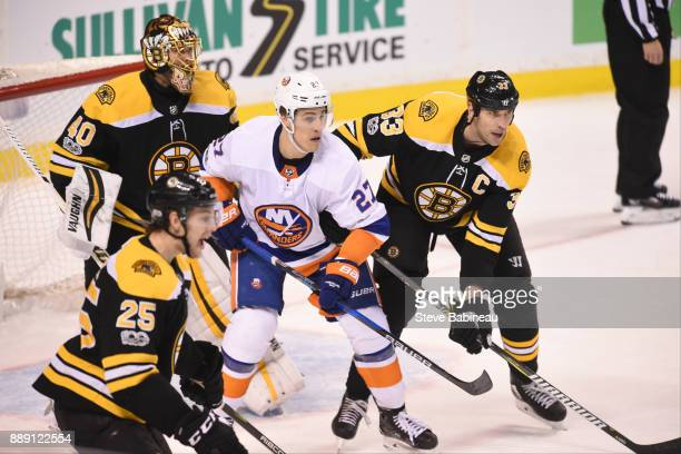 Anders Lee of the New York Islanders watches the play against Tuukka Rask and Zdeno Chara of the Boston Bruins at the TD Garden on December 9 2017 in...