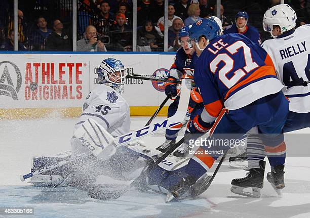 Anders Lee of the New York Islanders who already had two goals in the game gets the puck behind Jonathan Bernier of the Toronto Maple Leafs but it...