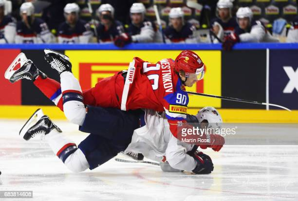 Anders Lee of the USA is smashed by Vladislav Namestnikov of Russia during the Russia v USA 2017 IIHF Ice Hockey World Championship match at Lanxess...