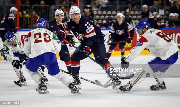 Anders Lee of USA and Marco Insam of Italy fight for the puck during the 2017 IIHF Ice Hockey World Championship game between USA and Italy at...