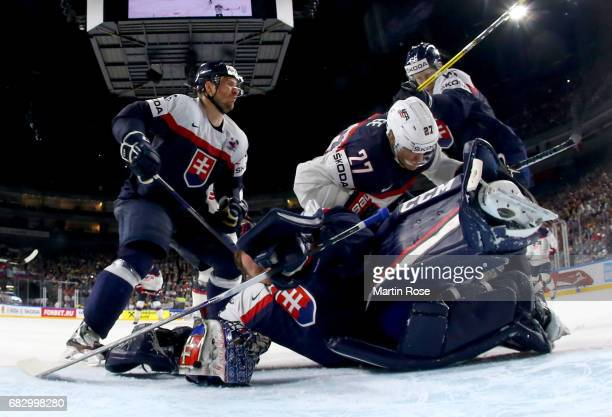 Anders Lee of USA slides into Julius Hudacek goaltender of Slovakia during the 2017 IIHF Ice Hockey World Championship game between Slovakia and USA...