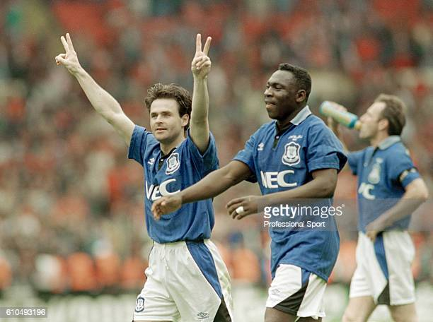 Anders Limpar and Daniel Amokachi celebrate victory after the FA Cup Final between Everton and Manchester United at Wembley Stadium in London 20th...