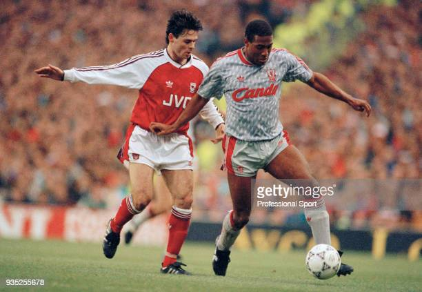 Anders Limpar of Arsenal closes down John Barnes of Liverpool during a Barclays League Division One match at Highbury on December 2 1990 in London...