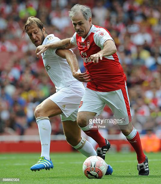 Anders Limpar of Arsenal Legends holds off Massimo Ambrosini of Milan during the Arsenal Foundation Charity match between Arsenal Legends and Milan...