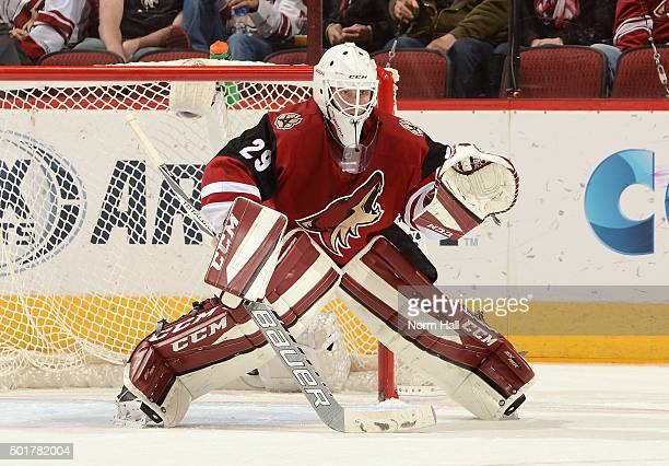Anders Lindback of the Arizona Coyotes gets ready to make a save against the Carolina Hurricanes at Gila River Arena on December 12 2015 in Glendale...