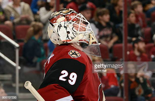 Anders Lindback of the Arizona Coyotes looks up at the scoreboard during a stop in play against the New Jersey Devils at Gila River Arena on January...