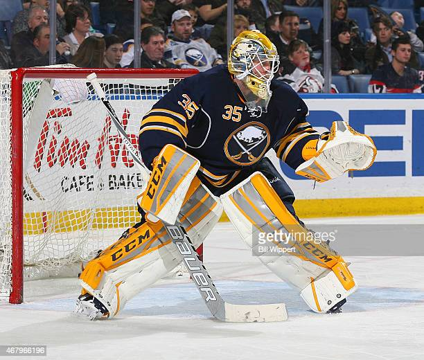 Anders Lindback of the Buffalo Sabres tends goal against the New Jersey Devils on March 20 2015 at the First Niagara Center in Buffalo New York
