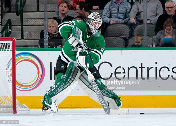 Anders Lindback of the Dallas Stars plays the puck outside of his net against the Columbus Blue Jackets at the American Airlines Center on January 6...