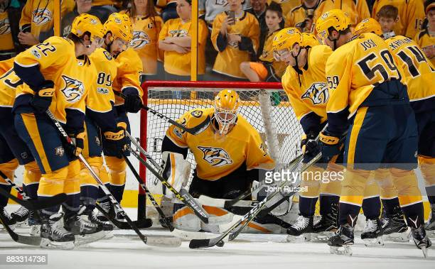 Anders Lindback of the Nashville Predators warms up in net prior to an NHL game against the Vancouver Canucks at Bridgestone Arena on November 30...