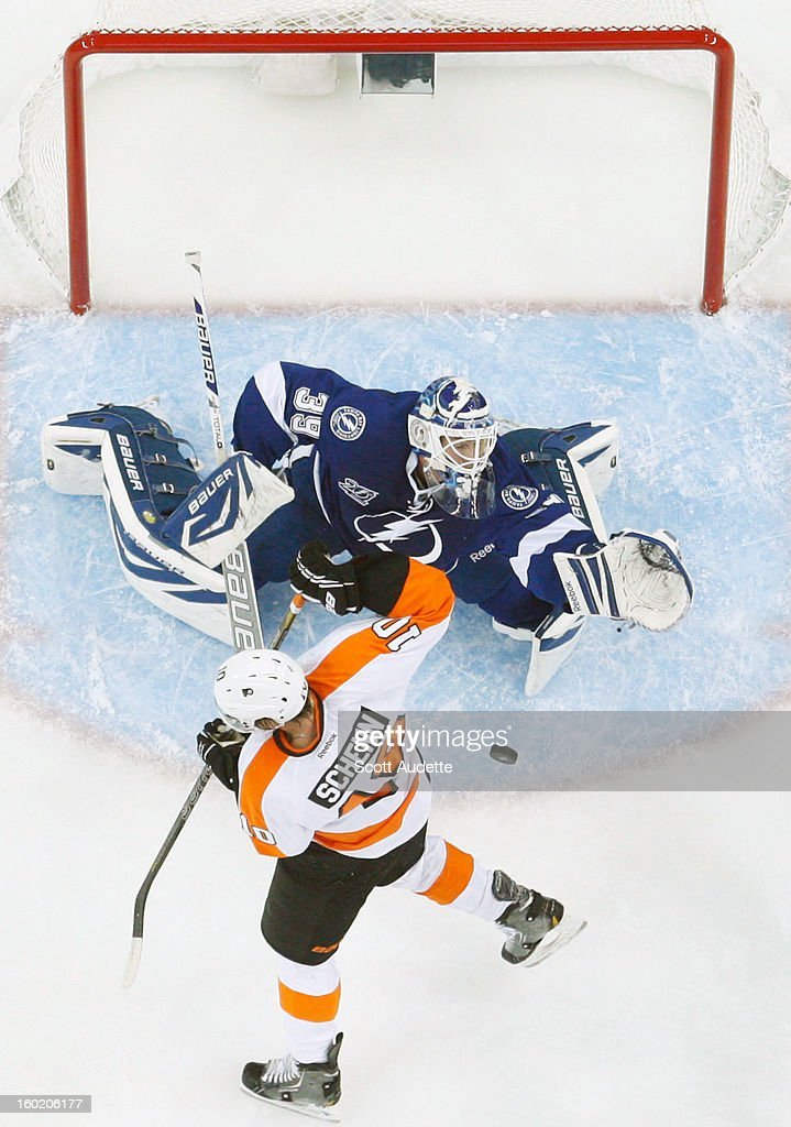 Anders Lindback #39 of the Tampa Bay Lightning defends the goal in front of Brayden Schenn #10 of the Philadelphia Flyers during the first period of an NHL game at the Tampa Bay Times Forum on January 27, 2013 in Tampa, Florida.