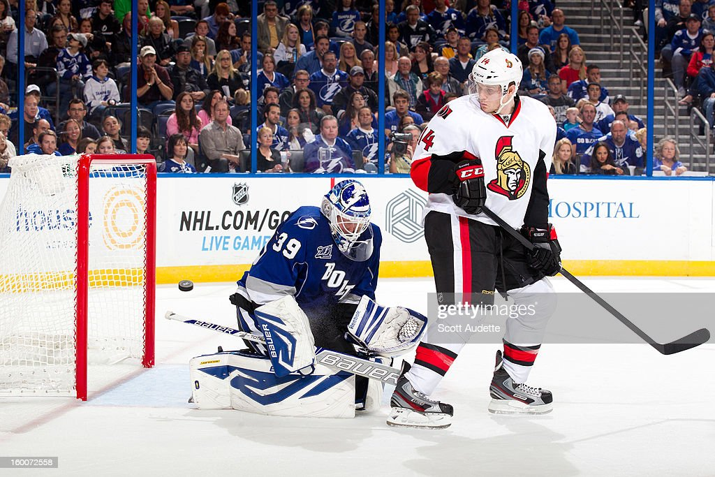 Anders Lindback #39 of the Tampa Bay Lightning is screened by Colin Greening #14 of the Ottawa Senators as the puck goes into the net during the second period at the Tampa Bay Times Forum on January 25, 2013 in Tampa, Florida.