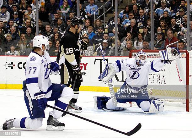 Anders Lindback of the Tampa Bay Lightning makes a glove save against the Tampa Bay Lightning during the game at Consol Energy Center on March 4 2013...