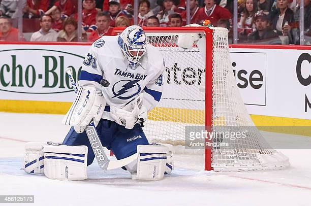 Anders Lindback of the Tampa Bay Lightning makes a save against the Montreal Canadiens in Game Three of the First Round of the 2014 NHL Stanley Cup...