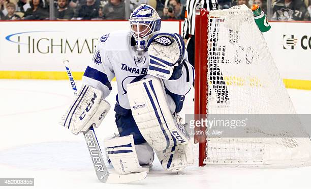 Anders Lindback of the Tampa Bay Lightning protects the net against the Pittsburgh Penguins during the game at Consol Energy Center on March 22 2014...