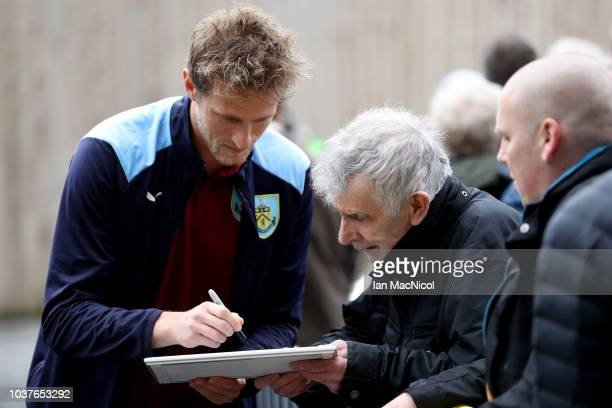 Anders Lindegaard of Burnley signs autographs as he arrives at the stadium prior to the Premier League match between Burnley FC and AFC Bournemouth...