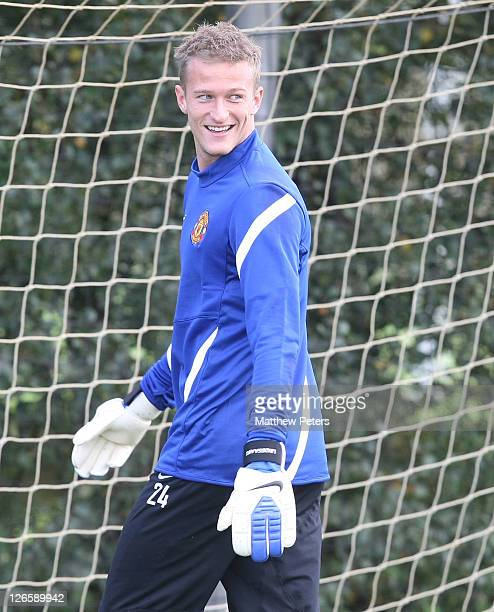 Anders Lindegaard of Manchester United in action during a first team training session ahead of their UEFA Champions League Group C match against FC...