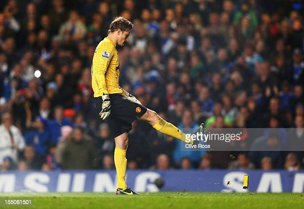 Anders Lindegaard of Manchester United kicks rubbish from the pitch during the Capital One Cup Fourth Round match between Chelsea and Manchester...