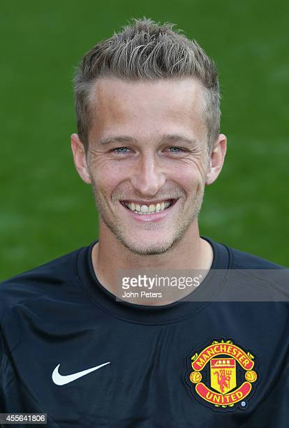 Anders Lindegaard of Manchester United poses during the annual club photocall at Old Trafford on September 16 2014 in Manchester England