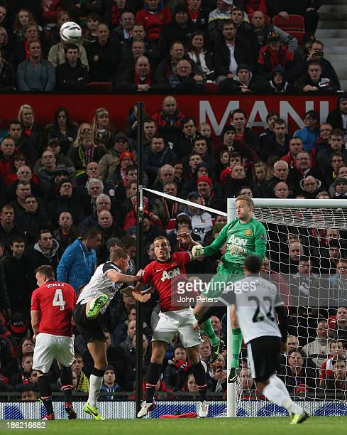 Anders Lindegaard of Manchester United punches the ball clear during the Capital One Cup Fourth Round match between Manchester United and Norwich...