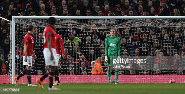 Anders Lindegaard of Manchester United reacts to conceding a goal to Wayne Routledge of Swansea City during the FA Cup Third Round match between...