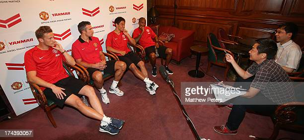 Anders Lindegaard Robin van Persie Shinji Kagawa and Ashley Young of Manchester United are interviewed at a press event for Yanmar on July 25 2013 in...