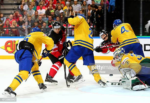 Anders Nilsson goaltender of Sweden blocks a shot of Jason Spezza of Canada during the IIHF World Championship group A match between Sweden and...