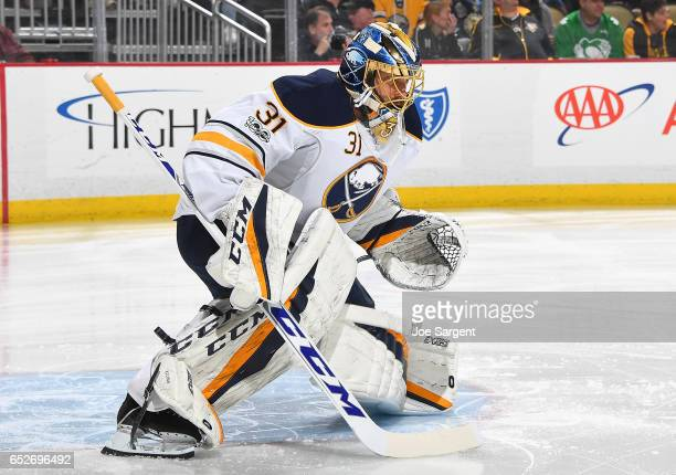 Anders Nilsson of the Buffalo Sabres defends the net against the Pittsburgh Penguins at PPG Paints Arena on March 5 2017 in Pittsburgh Pennsylvania
