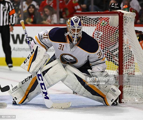 Anders Nilsson of the Buffalo Sabres follows the action against the Chicago Blackhawks at the United Center on January 5 2017 in Chicago Illinois The...