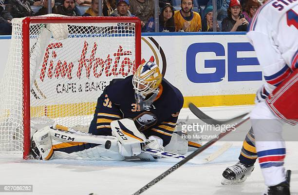 Anders Nilsson of the Buffalo Sabres makes a save against the New York Rangers during an NHL game at the KeyBank Center on December 1 2016 in Buffalo...