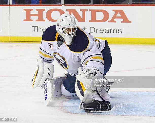 Anders Nilsson of the Buffalo Sabres skates against the New York Islanders at the Barclays Center on December 23 2016 in the Brooklyn borough of New...