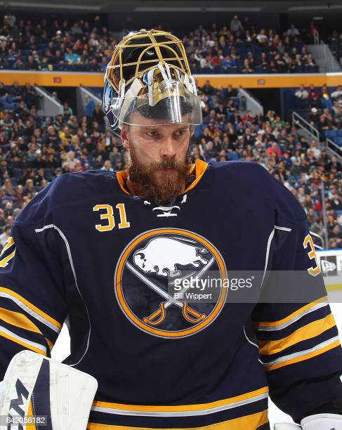Anders Nilsson of the Buffalo Sabres takes a break against the San Jose Sharks during an NHL game at the KeyBank Center on February 7 2017 in Buffalo...