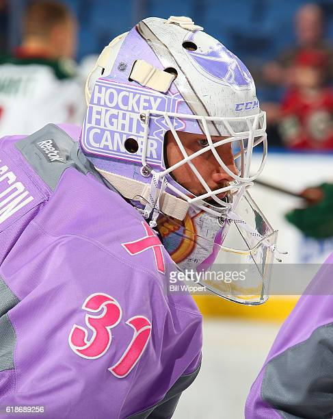 Anders Nilsson of the Buffalo Sabres warms up wearing Hockey Fights Cancer gear before an NHL game against the Minnesota Wild at the KeyBank Center...