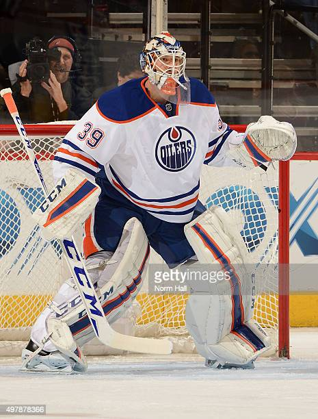 Anders Nilsson of the Edmonton Oilers gets ready to make a save against the Arizona Coyotes at Gila River Arena on November 12 2015 in Glendale...