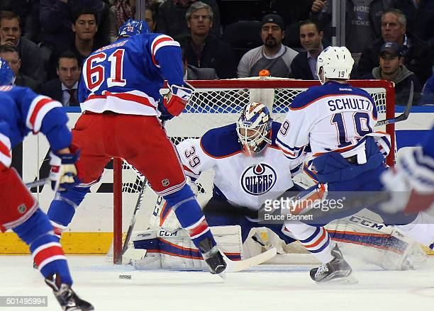 Anders Nilsson of the Edmonton Oilers makes the first period save on Rick Nash of the New York Rangers at Madison Square Garden on December 15 2015...