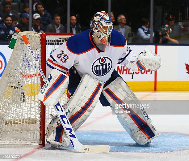 Anders Nilsson of the Edmonton Oilers prepares for a shot against the Toronto Maple Leafs during game action on November 30 2015 at Air Canada Centre...
