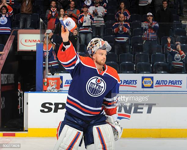 Anders Nilsson of the Edmonton Oilers salutes the crowd after winning the game against the Buffalo Sabres on December 6 2015 at Rexall Place in...