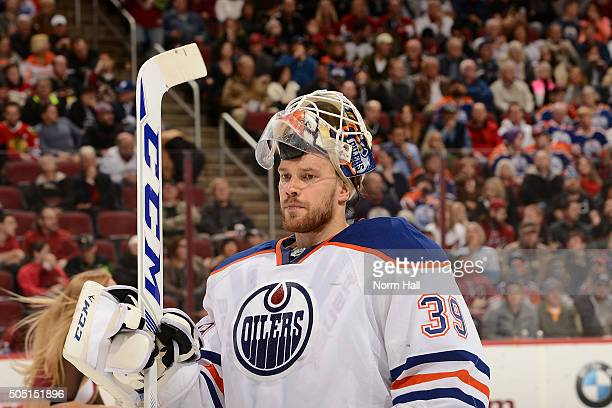 Anders Nilsson of the Edmonton Oilers skates to his bench during a stop in play against the Arizona Coyotes at Gila River Arena on January 12 2016 in...