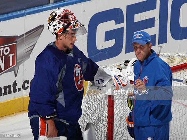 Anders Nilsson of the New York Islanders and coach Mike Dunham discuss goaltending at the prospects evaluation camp at Nassau Veterans Memorial...