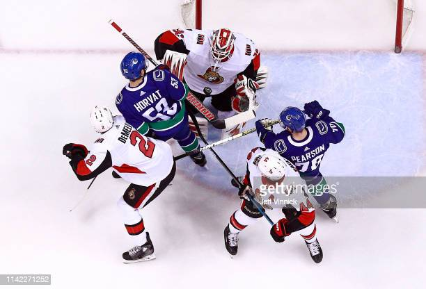 Anders Nilsson of the Ottawa Senators makes a save off the shot of Bo Horvat of the Vancouver Canucks during their NHL game at Rogers Arena March 20...