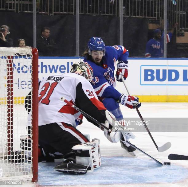 Anders Nilsson of the Ottawa Senators stops Mika Zibanejad of the New York Rangers at Madison Square Garden on April 03 2019 in New York City The...