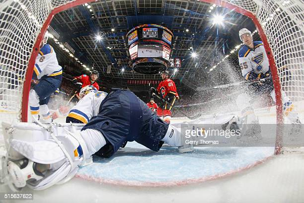 Anders Nilsson of the St Louis Blues makes a save through traffic against the Calgary Flames at Scotiabank Saddledome on March 14 2016 in Calgary...