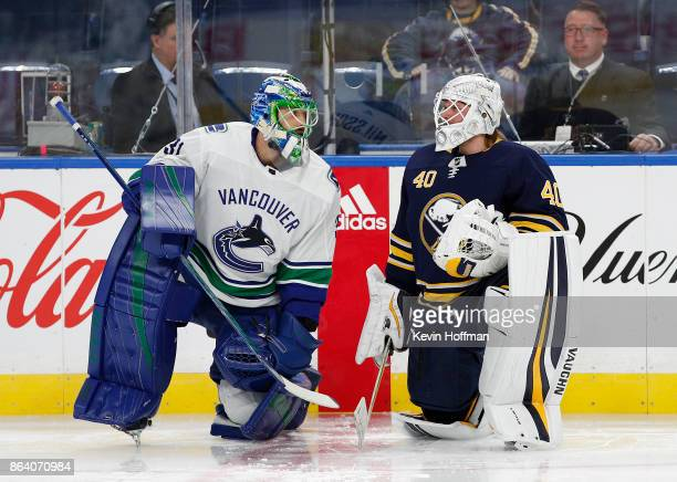 Anders Nilsson of the Vancouver Canucks and Robin Lehner of the Buffalo Sabres talk during warmups before the game at the KeyBank Center on October...