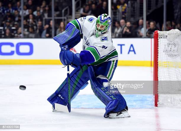Anders Nilsson of the Vancouver Canucks clears the puck during the second period against the Los Angeles Kings at Staples Center on November 14 2017...